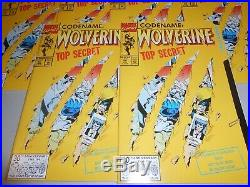 Huge Lot of 100 copies of 1992 Wolverine Comic #50 Weapon X File Die-Cut Cover